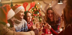 Young group of friends toasting to Christmas