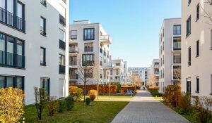 Cluster of apartment blocks with walkway and grass