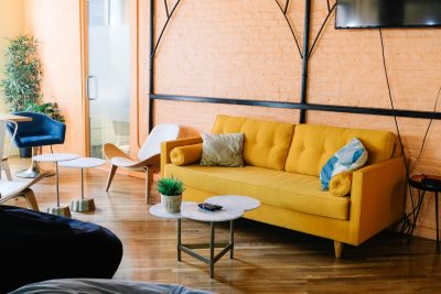 Yellow couch in living room of apartment